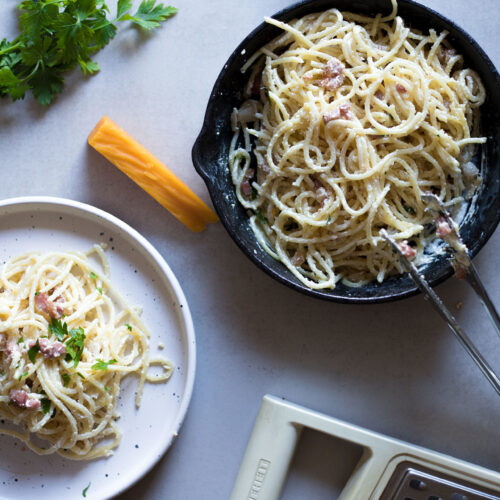 This Eggless Spaghetti Carbonara is Low FODMAP and lactose-free with a dairy-free option. It's a flavorful, comforting and super creamy eggless alternative to the traditional carbonara spaghetti recipe.