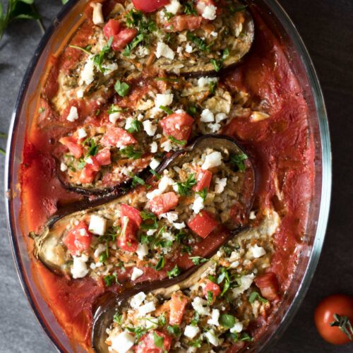 Simple and healthy Low FODMAP Veggie Stuffed Eggplant. Option to make it completely vegan. A flavorful, comforting and super delicious dish.