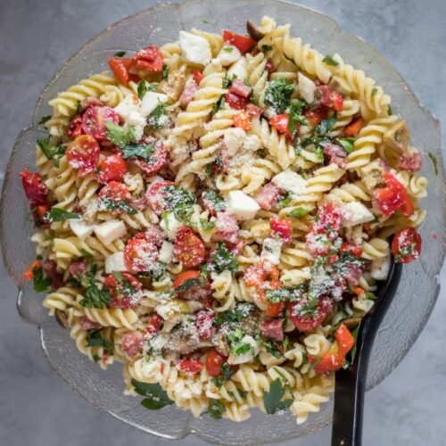 Simple and Refreshing Low FODMAP Italian Pasta Salad, with an option to make it vegan. It's super easy to make, healthy and IBS Friendly.