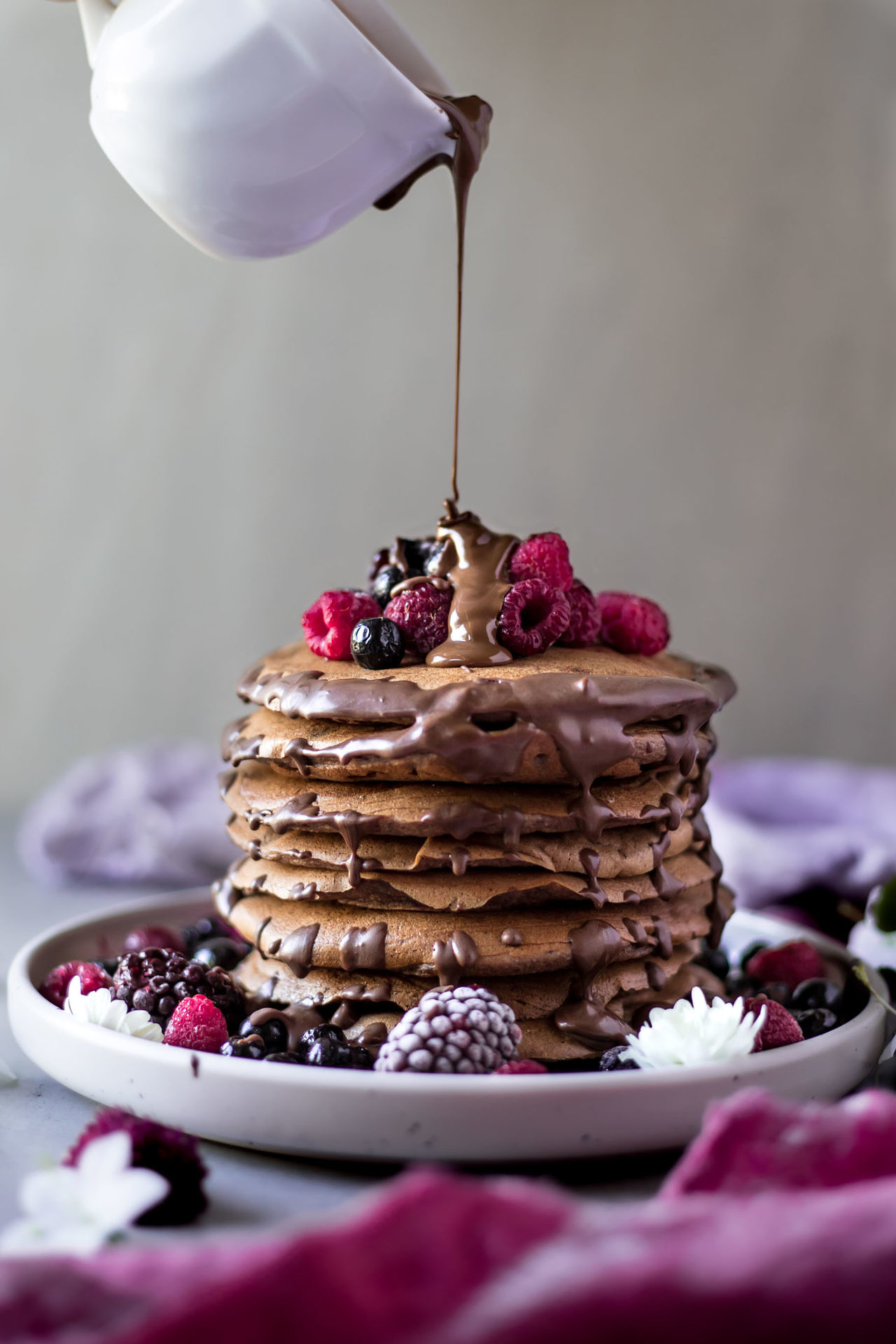These gluten free chocolate banana pancakes are vegan and low FODMAP. They are so fluffy, flavorful, chocolaty and super delicious.