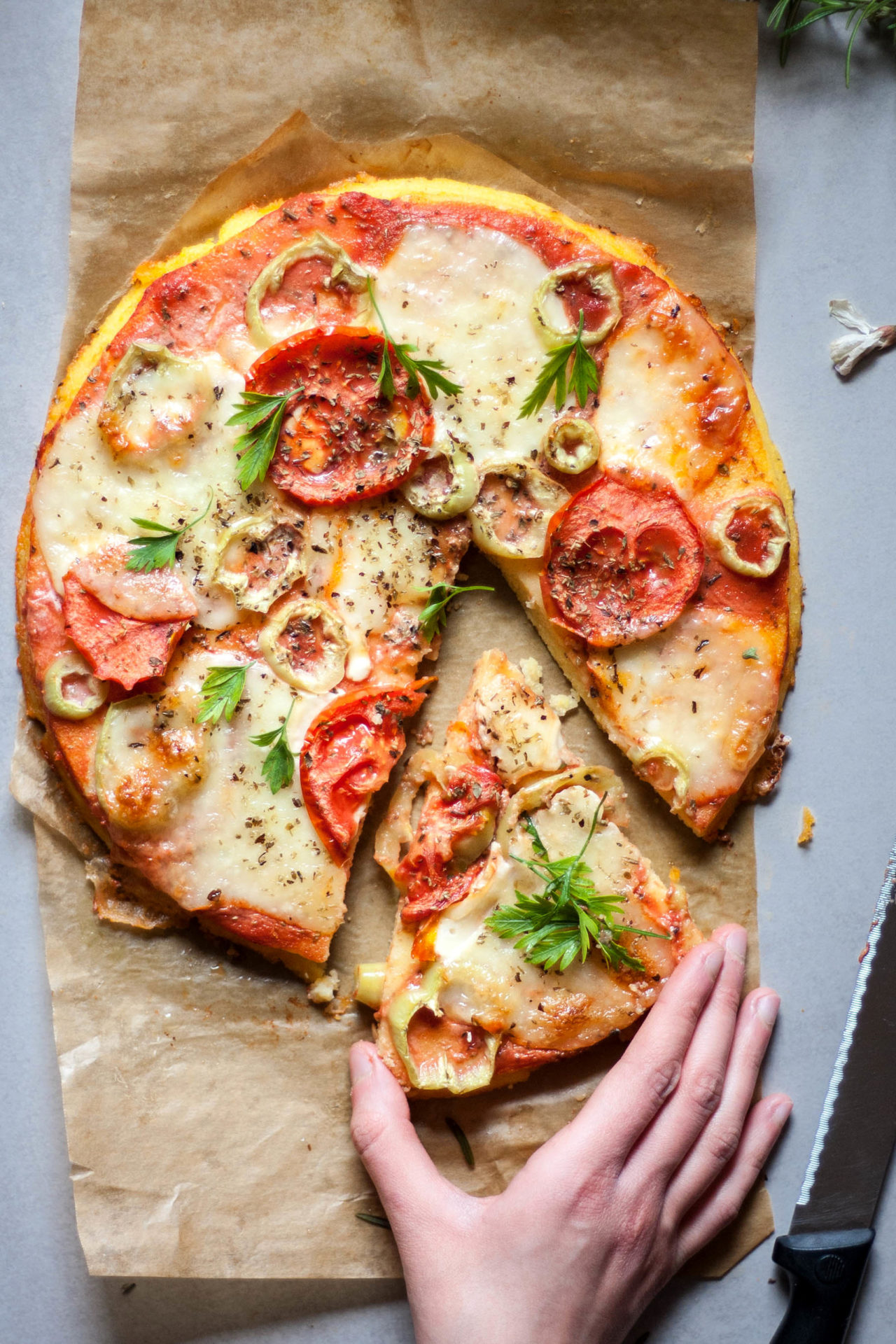 This Polenta Pizza is simple to make,  naturally gluten-free and low FODMAP. It is made from 4 simple ingredients and takes only 30min to make.