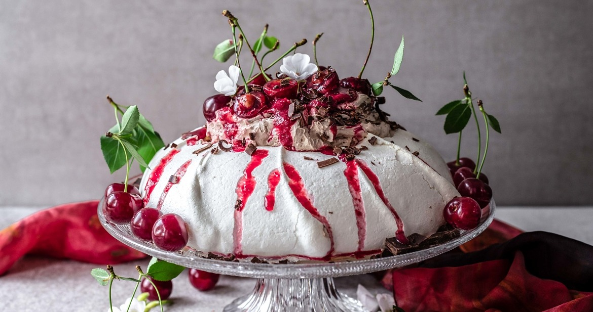 This Black Forest Pavlova is crunchy on the top, soft and marshmallowy in the middle, perfectly sweetened, chocolaty, cherry-infused and so delicious.