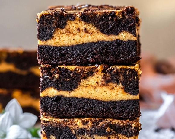 These Gluten-Free Pumpkin Cheesecake Brownies are perfectly sweetened, super chocolaty, pumpkin-infused, gooey, and just so delicious!